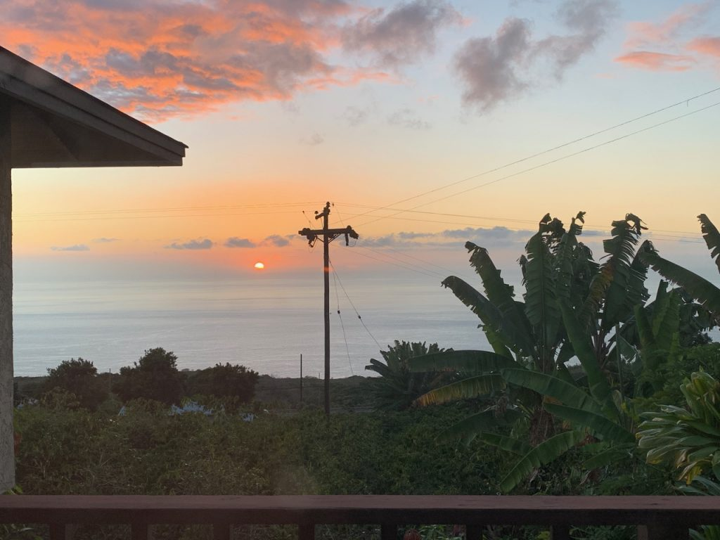 Kona sunset photo with utility pole in the foreground.