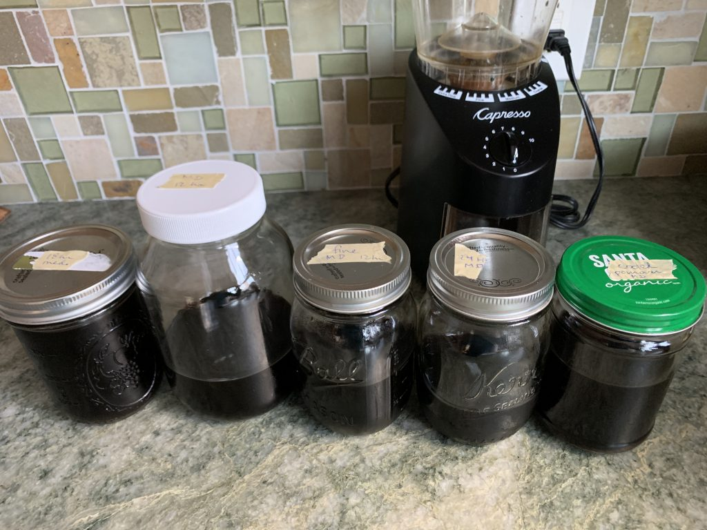 Five different cold brew experiments in jars.